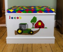 pine toy box after upcycling with tractor design