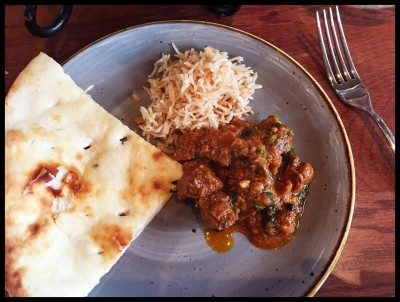 Curry, rice and naan on a plate