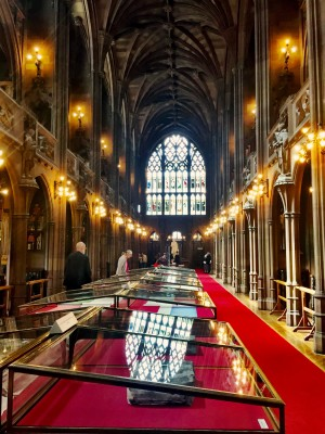 The reading room at John Rylands with stained glass reflection