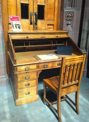 100 year old writing desk outside the reading room at John Rylands Library