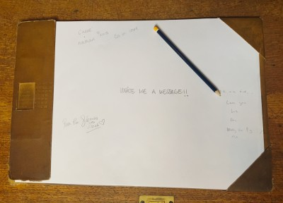 Writing pad at John Rylands, inviting visitors to leave a message