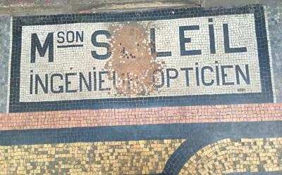 Mosaic shop names in Paris arcade