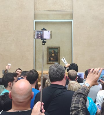 Tourist gathering round the Mona Lisa, Paris