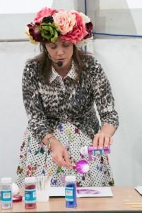 Kirstie making glitter baubles at The Handmade Fair