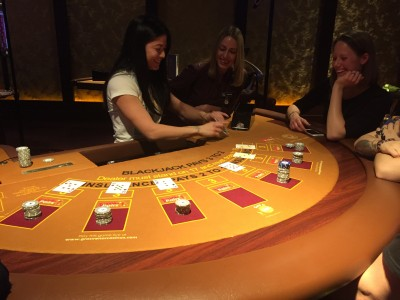 Trying her hand as dealer at the blackjack table, Grosvenor Casino, Didsbury