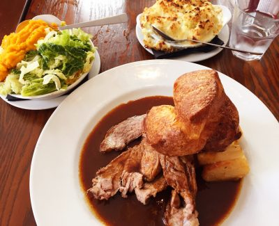 Roast beef with potatoes, parsnips and Yorkshire pudding and veg on the side at TNQ Restaurant