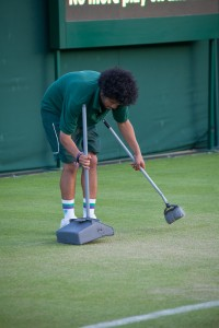 sweeping the court at the end of the day